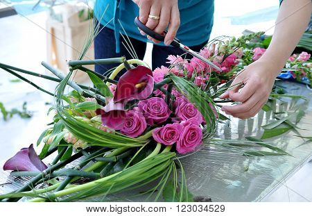 People finishing beautiful and rich bouquet on the competition for florists in Sofia, Bulgaria