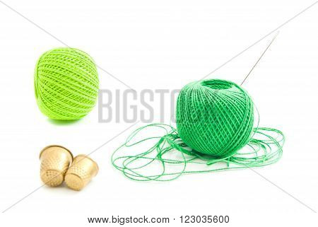 Spools Of Green Thread And Thimbles