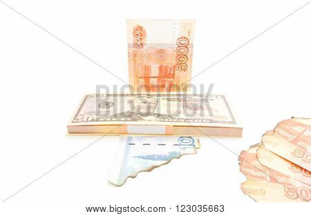 Dollars And Burnt Rubles On White