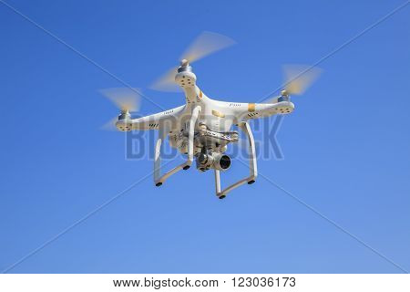 Bangkok Thailand - March 13: Dji Phantom Drone Hover Flying With Camera Recoard Lens Against Blue Sk