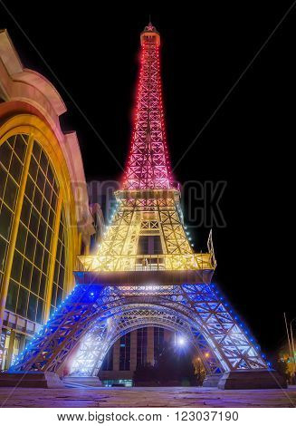 ALMATY KAZAKHSTAN - MARCH 23 2016: Night view of reduced copy of Eiffel Tower on the street Furmanova. Almaty is the largest city in Kazakhstan and was the country's capital until 1997.