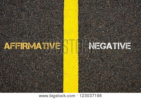 Antonym concept of AFFIRMATIVE versus NEGATIVE written over tarmac road marking yellow paint separating line between words