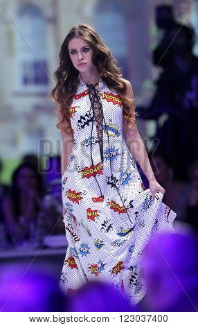 Sofia Bulgaria - March 23 2016: A model walks the runway at Sofia Fashion Week runway show. The fashion show is held for a second time in Bulgaria's capital.