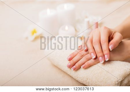 Beautiful French manicure in spa studio set