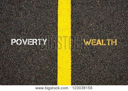 Antonym concept of POWERTY versus WEALTH written over tarmac, road marking yellow paint separating line between words