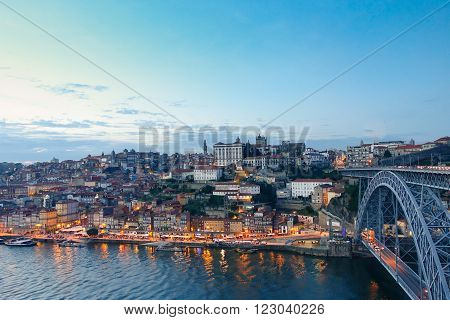 PORTO PORTUGAL - OCTOBER 26 2015: Panorama of Porto with famous Dom Luis I bridge - Top view of famous Portugal city at blue hour time - Travel around Europe concept - Soft focus