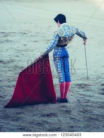 A bullfighter awaiting for the bull in the bullring with estoque and muleta. Corrida de toros