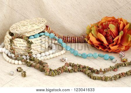 Basket of semi-precious stones on gunny background - gems for handmade
