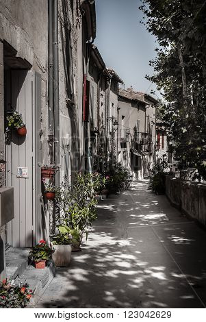 sweet village street in france in summer time