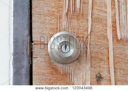 Door knob on old wooden door .