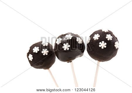 Three chocolate cakepops on isolated background. Holiday delicacy