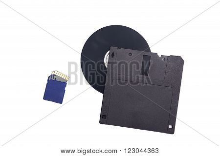 Damaged memory card and floppy disc on a white background