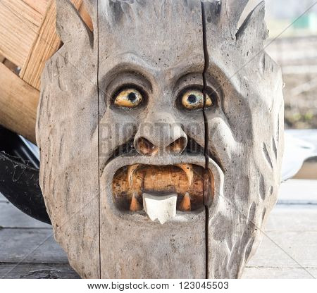 Old wooden mask with the image of hell
