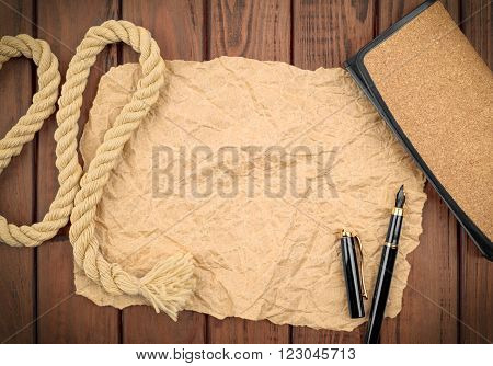paper and other items on a wooden background