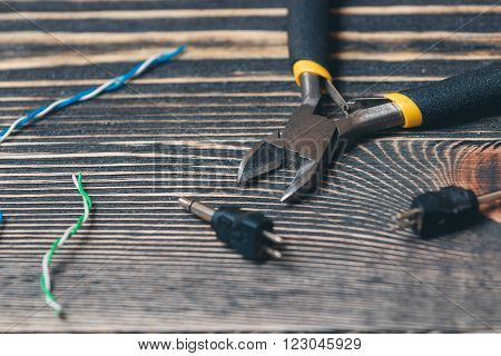 electric tools on a brown wooden background