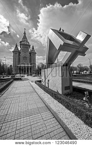TIMISOARA, ROMANIA-MARCH 18, 2015: Fisheye view in black and white with the Metropolitan Cathedral and the memorial monument of the deads in anti-communist revolution from december 1989 in Timisoara Romania.