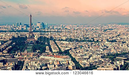 Vintage aerial view from Montparnasse tower with Eiffel tower and La Defense district in Paris France.