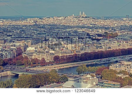 Vintage panorama and aerial view from Eiffel tower in Paris France with Basilica Sacre Coeur on background.