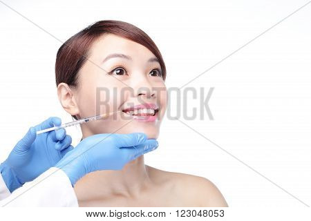 Close up of cosmetic injection to the pretty woman face. Isolated on white background asian