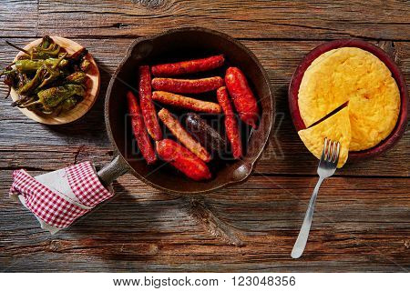 Tapas spanish potatoes omelette and sausages chorizo morcilla green peppers