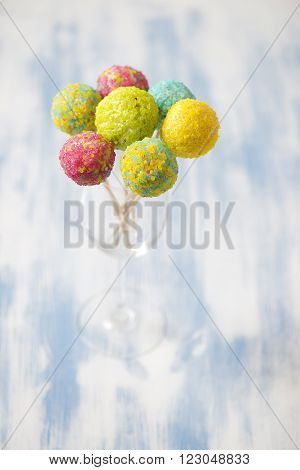 Colorful cakepops in a glass for party
