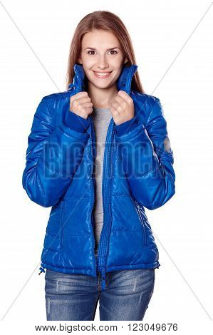 Casual caucasian woman smiling standing in blue puffed jacket, over white background