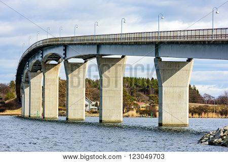 The underside of the Senoren bridge in the Blekinge archipelago of Sweden. Sun is shining on the pillars.