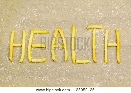 Health concept with french fries and salt