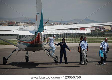 ANKARA/TURKEY-MAY 6: Passengers at the THK Etimesgut Airport during the demonstration flight with Cessna 206 Caravan aircraft. May 6, 2012-Ankara/Turkey