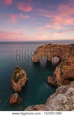 The magical landscape sunset beach Marinha in Portugal.