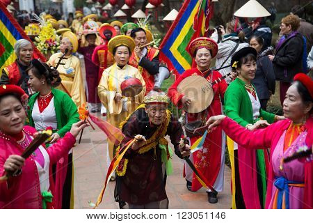 Hanoi, Vietnam - Jan 27, 2016: Asian civilian artists performing a spiritual dance within a festival to welcome lunar new year at Temple of Literature in Hanoi capital, Vietnam.
