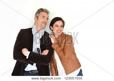 Middle-aged couple standing on white background