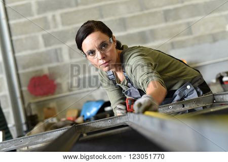 Metalworker woman in workshop