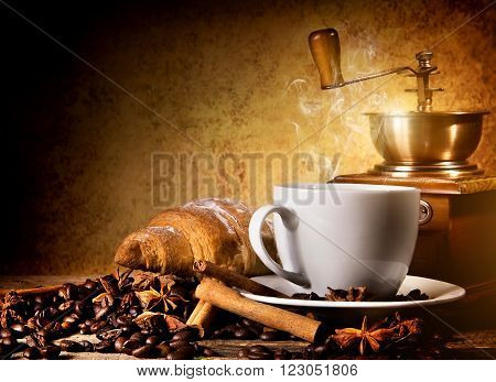 Coffee with fresh croissant and coffee mill