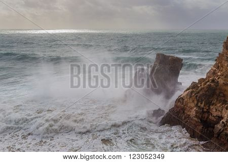 Scattered waves on the rocks during a storm.
