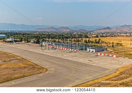 PODGORICA, MONTENEGRO - AUGUST 11, 2015: Aerial view of the airport building aerial on sunny summer day.