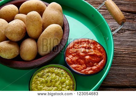 Papas arrugas al mojo Canary islands wrinkled potatoes with green and red sauces