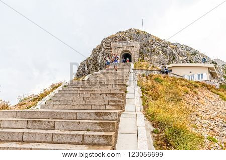 LOVCEN, MONTENEGRO - AUGUST 11, 2015: People at the stairs to the tunnel on the way to the Njegos mausoleum in Lovcen mountain and national park in southwestern Montenegro.