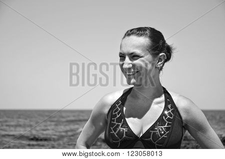 Portrait of yound woman outdoors in Crimea on the beach