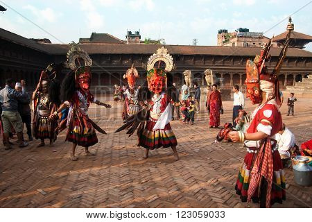 BHAKTAPUR NEPAL - APRIL 19 2013:Several unidentified Lama perform a ritual dance called Bhairav Dance in Bisket Jatra is which is held during the celebration of Nepali New Year on the square in Bhaktapur.