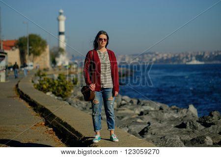 Young caucasian girl walks on the coast the Sea of Marmara in Istanbul