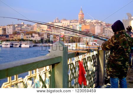 fishing on Galata Bridge sunset view Istanbul. Selective focus