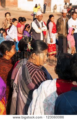 BHAKTAPUR NEPAL - APRIL 19 2013:Residents of Bhaktapur is participants and spectators watch a ritual dance called Bhairav Dance in Bisket Jatra is which is held during the celebration of Nepali New Year on the square in Bhaktapur.