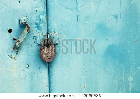 Old lock on the blue door. lock on the door of an old farmhouse. true village style. close-up. focus on lock