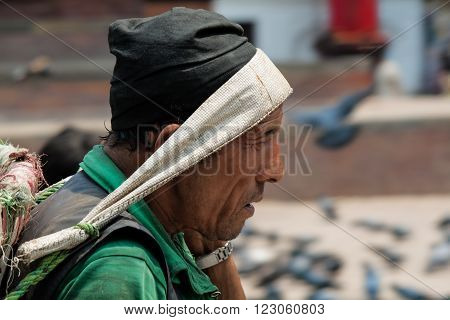 Katmandu, Nepal -  April 15 2013: Nepali Man With A Basket For Carrying Heavy Loads On Their Heads.