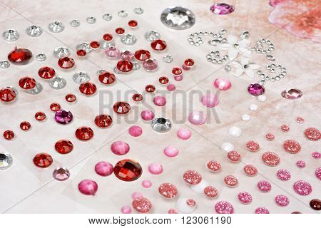 Rhinestones scattered on soft pink vintage background