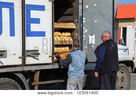 Murmansk, Russia - august 27, 1012, Uploading products from bakery bread van