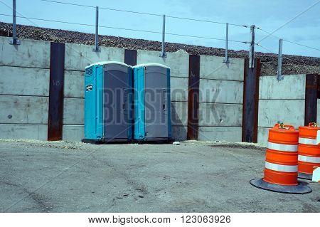 JOLIET, ILLINOIS / UNITED STATES - APRIL 12, 2015: Portable toilets are available next to the railroad tracks in downtown Joliet.