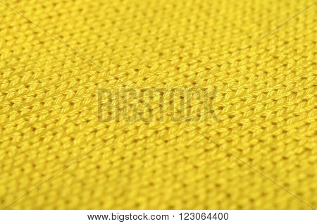 Piece of knitting work - yellow yarn stitches - macro