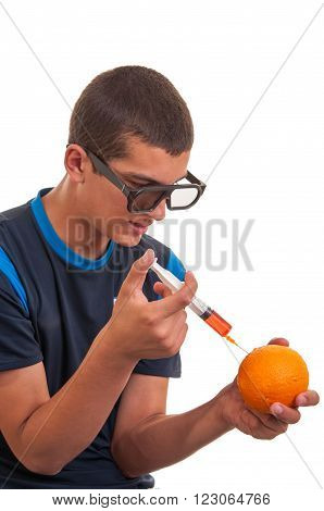 Young teen happy to do experiments with fruits for chemistry lab. Concept for genetically modified foods(GMO)